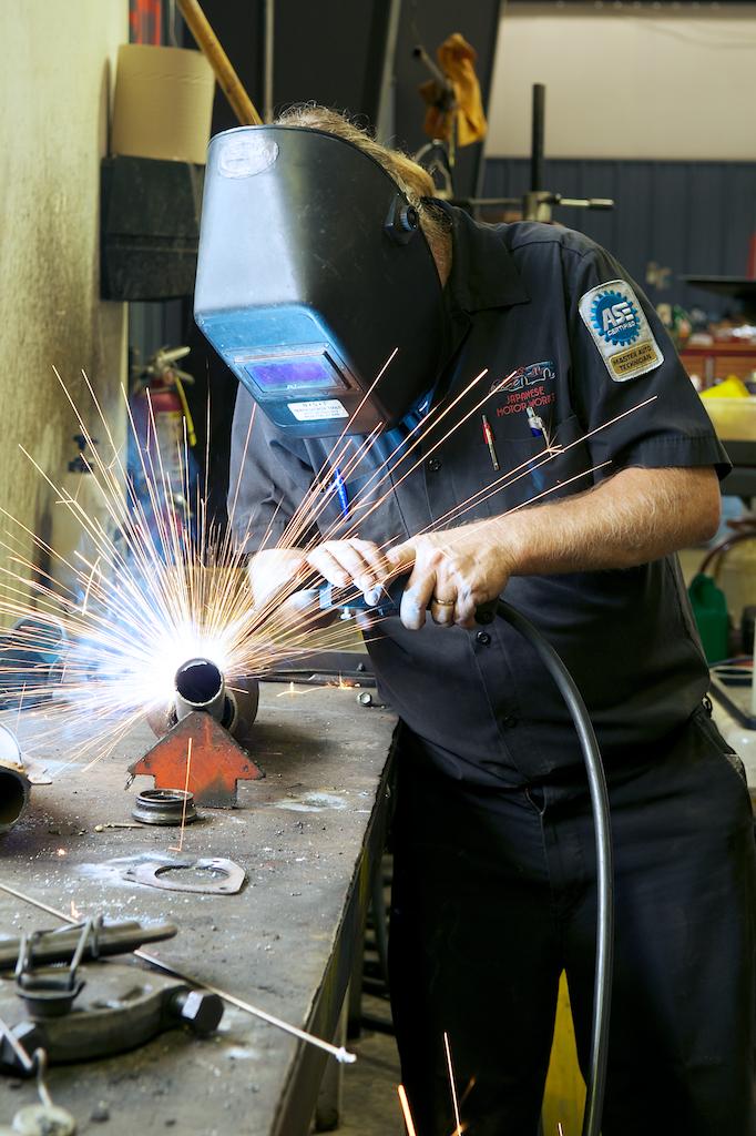 Auto mechanic welding.